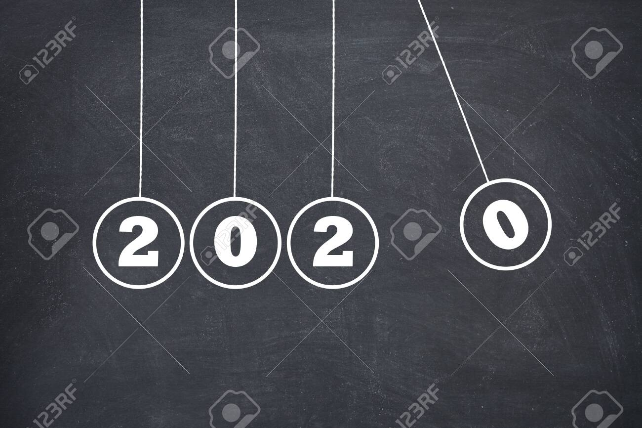 New Year 2020 Newtons Cradle on Chalkboard, new year concept - 136510173