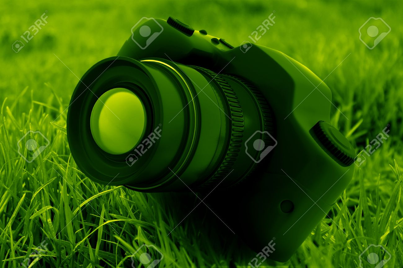 Dslr Camera On Green Background Stock Photo Picture And Royalty