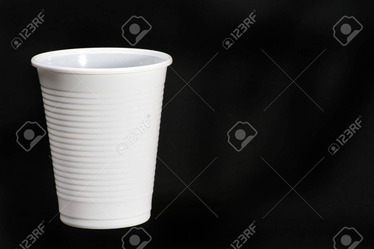 White plastic cup isolated on black surface. - 706268