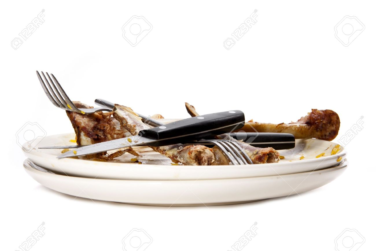 A stack of dirty plates with bones. - 8455519