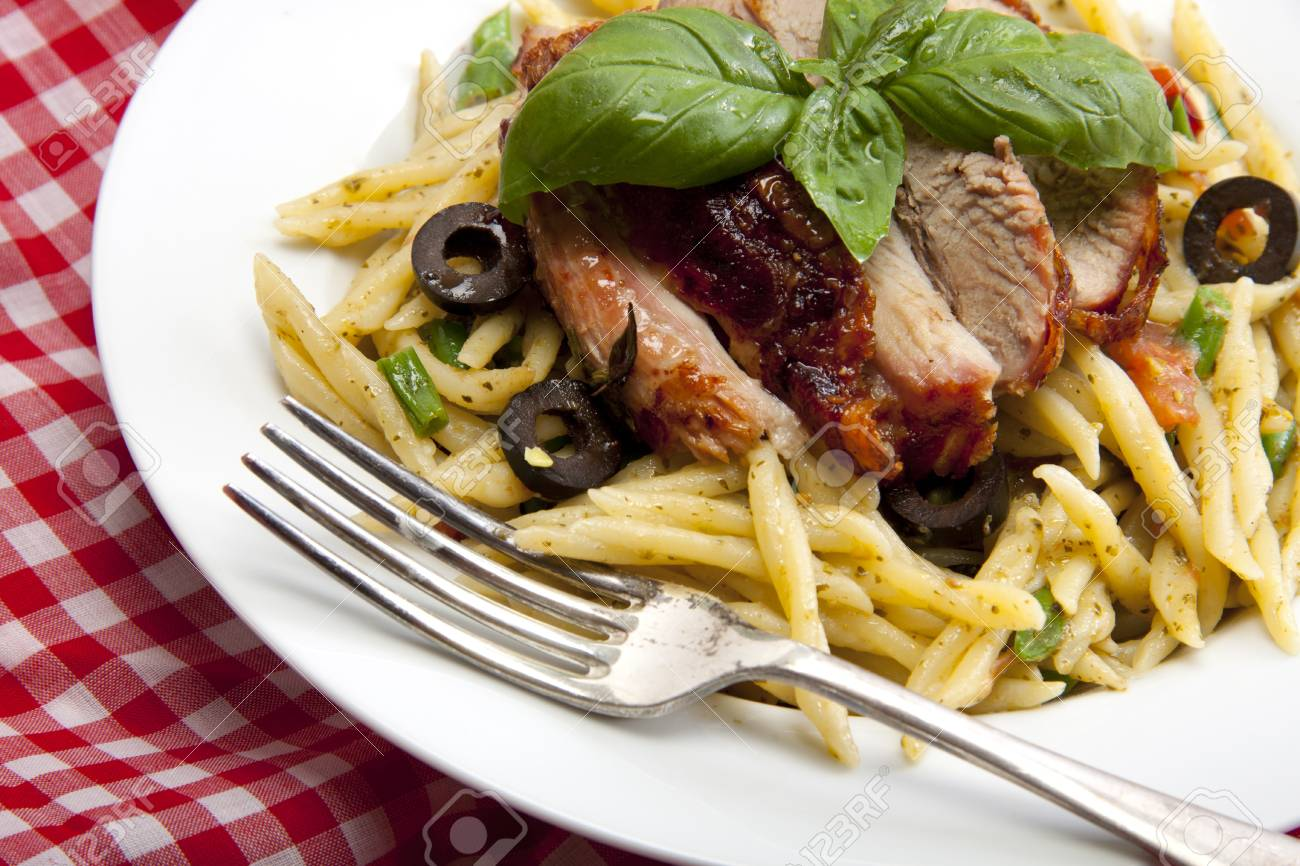 A delicious plate of pesto past toped with roasted turkey. Stock Photo - 9660317