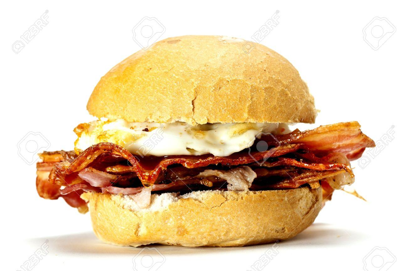 A delicious bacon and egg bun on a white background. Bacon and egg bun. - 13272306