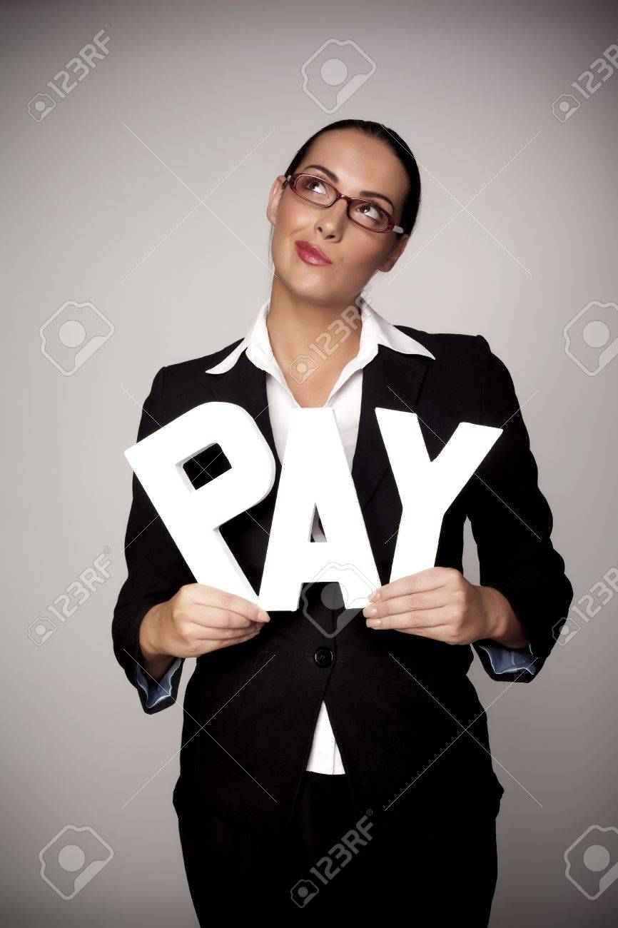 A income concept image of a woman holding letters that spell out the word pay demonstrating fare pay for woman - 16120310