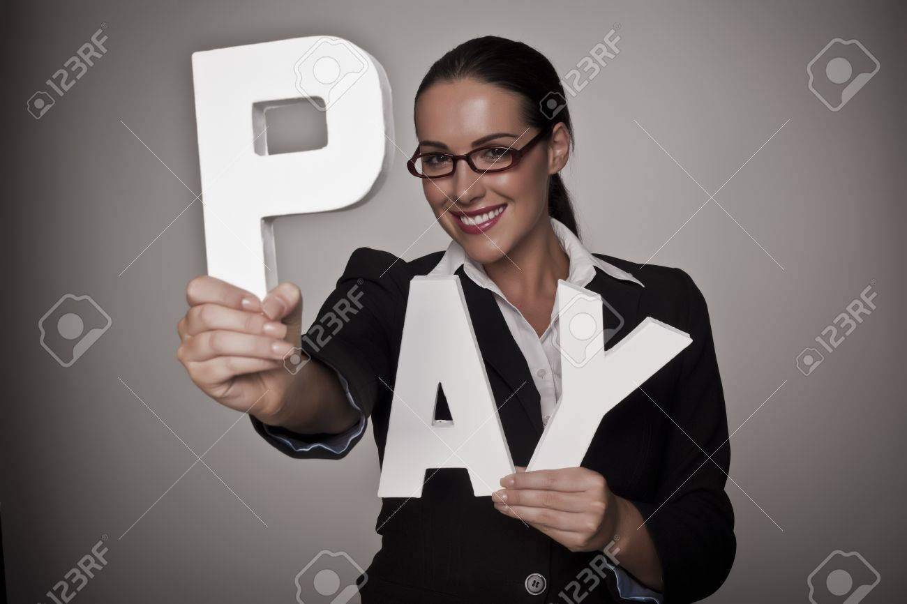 A income concept image of a woman holding letters that spell out the word pay demonstrating fare pay for woman - 16547616