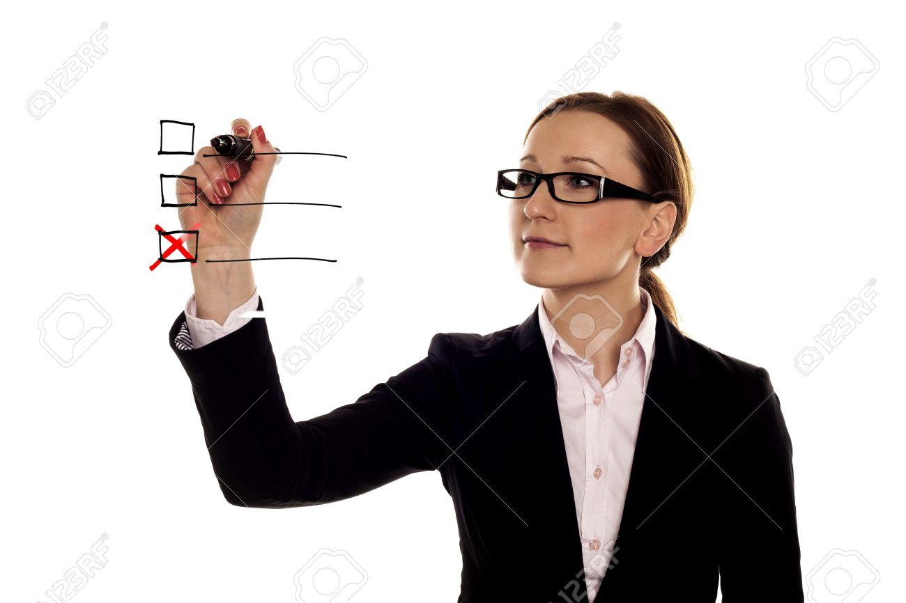 A businesswoman making a red cross on a three point checklist Stock Photo - 18129809