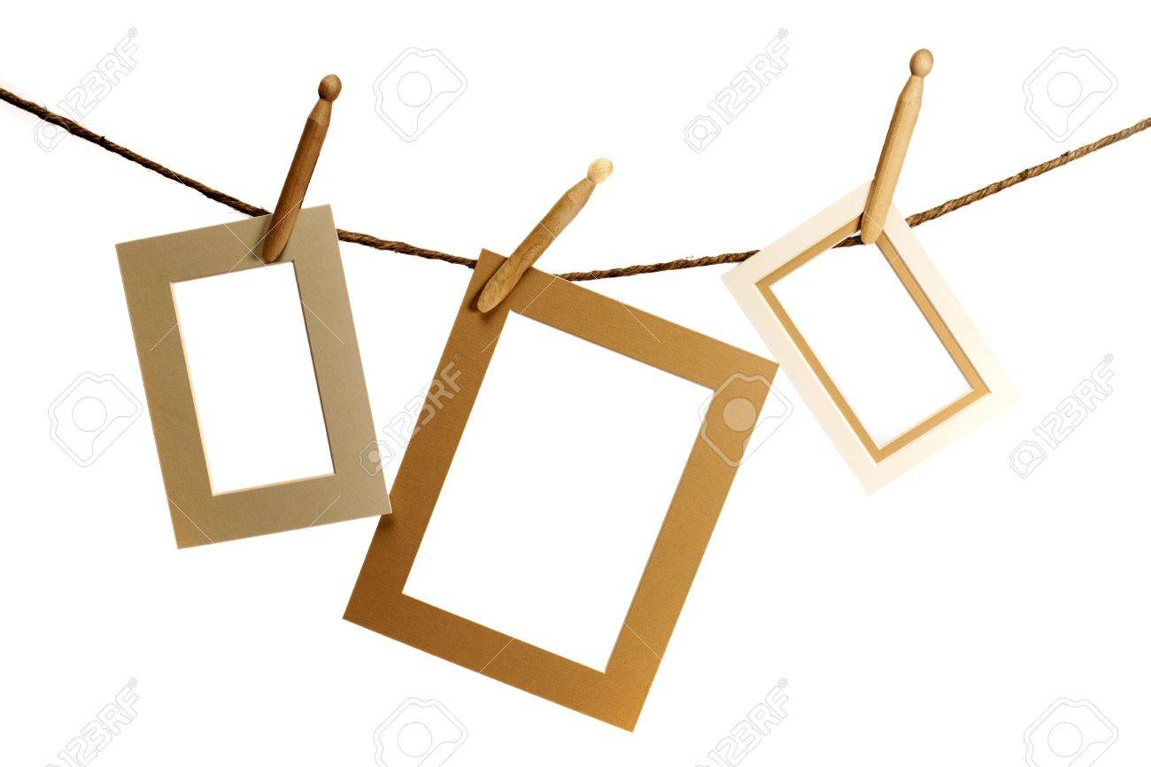 Three frames hanging from a rope over a white background - 19982192