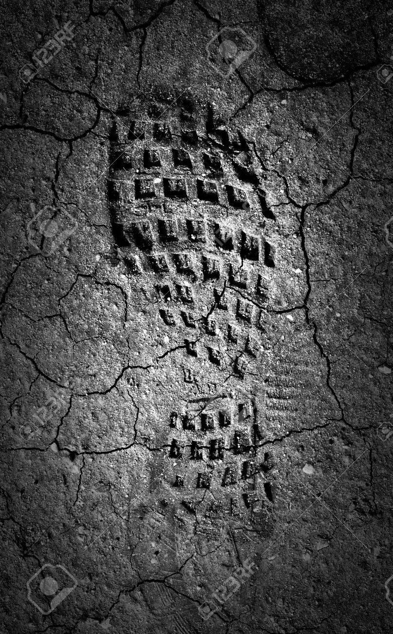 Forgotten footprint in the moonlight A abstract image of a black and white image of a boot print in dried out mud - 29206020