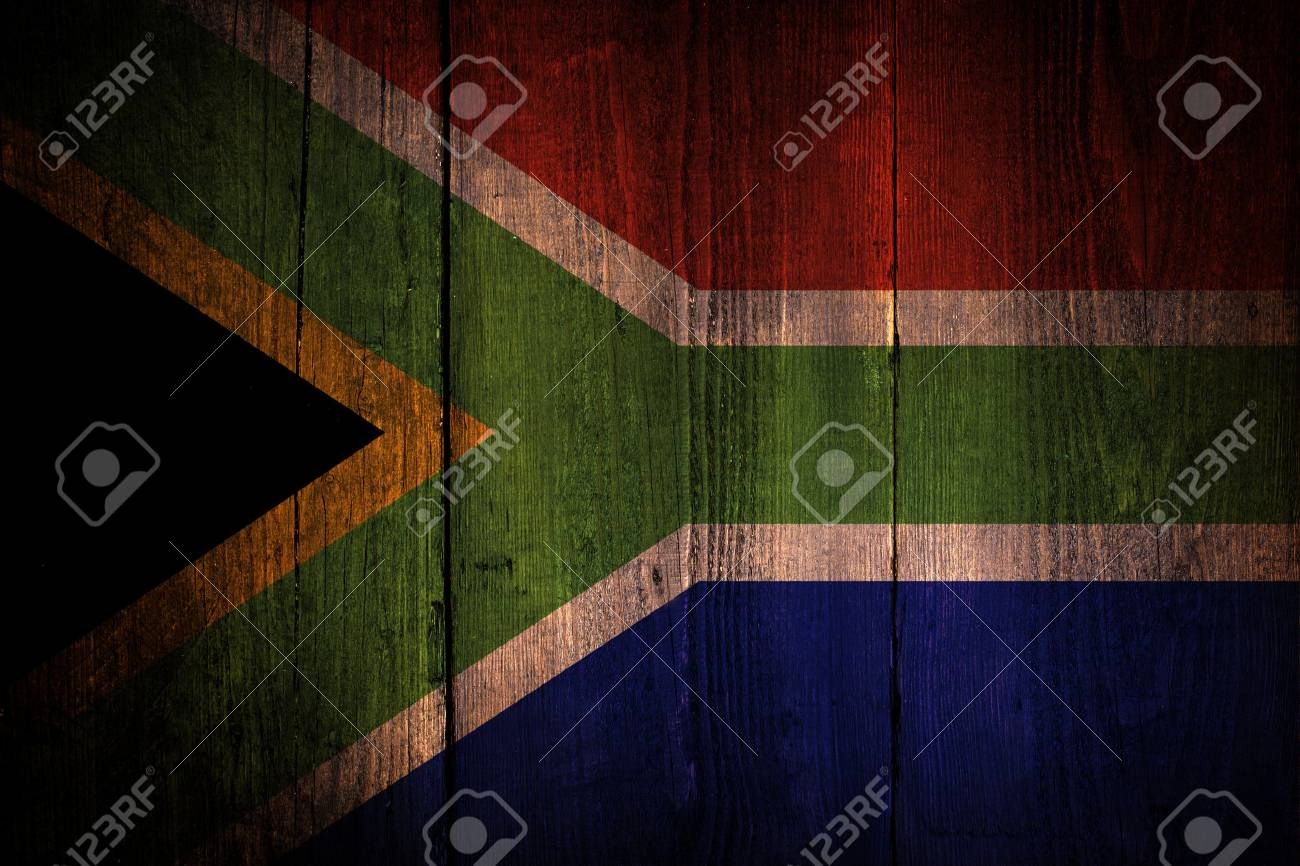 An South African flag on a grunge wooden background - 29871210