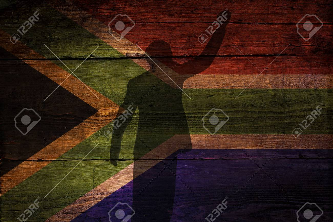 An South African flag on a grunge wooden background with a shadow overly for freedom - 29871236