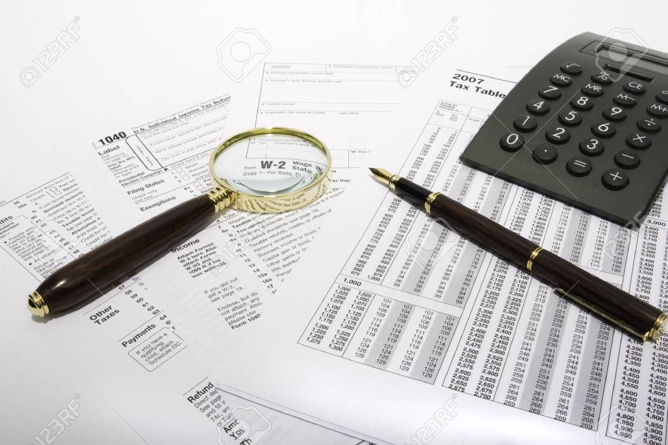 Tax form with calculator fountain pen and magnifying glass stock tax form with calculator fountain pen and magnifying glass stock photo 2486870 falaconquin