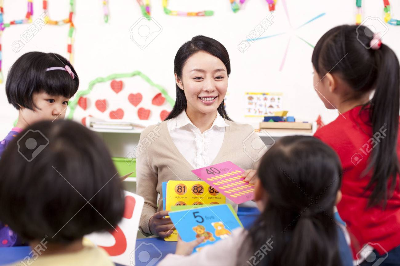 Kindergarten Teacher Teaching Children Maths Stock Photo, Picture ...