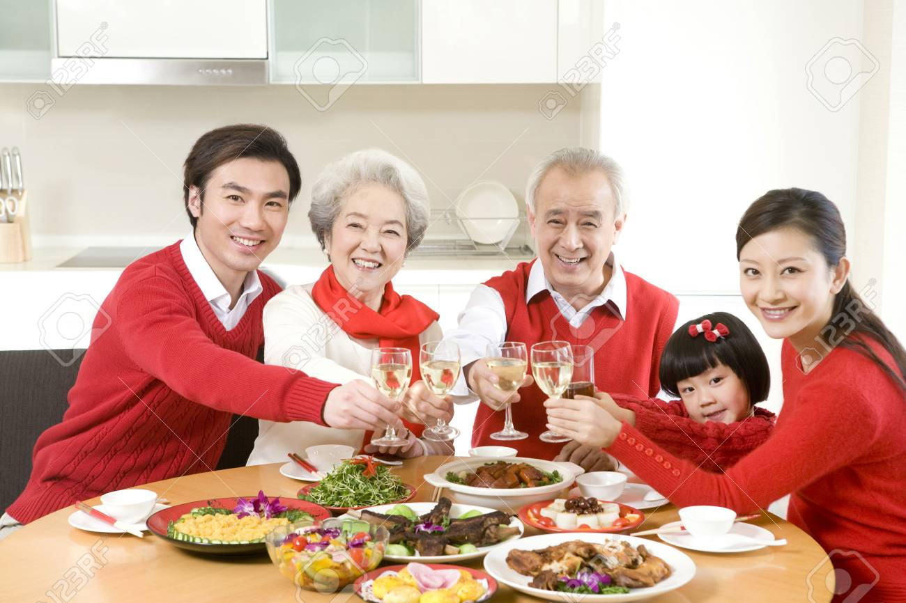 three generations enjoying a chinese new year dinner together stock photo 74927140 - Chinese New Year Dinner
