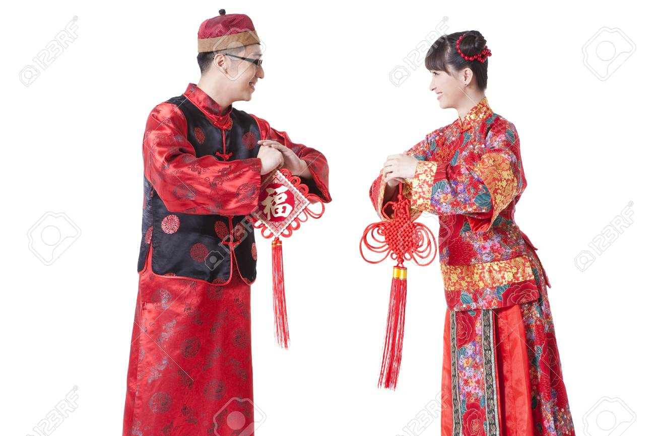 Young couple in traditional chinese clothing greeting for chinese stock photo young couple in traditional chinese clothing greeting for chinese new year m4hsunfo