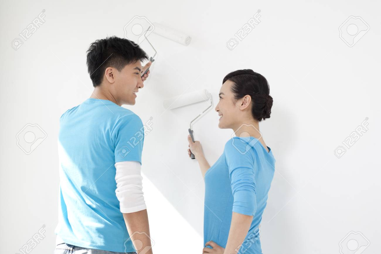 Happy Couple Painting Together Stock Photo