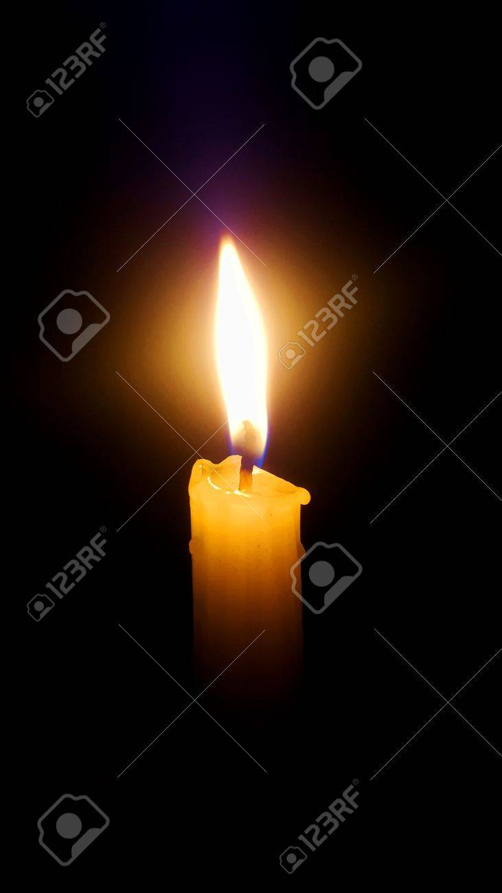 Candle in the dark Stock Photo - 66120278
