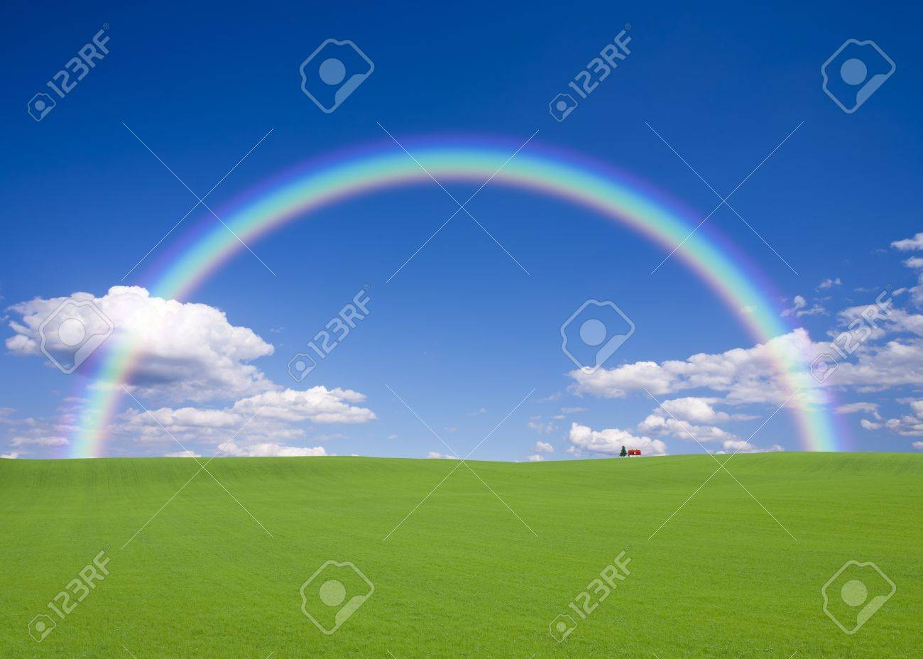 Red roof house on the hill with rainbow Stock Photo - 9965889