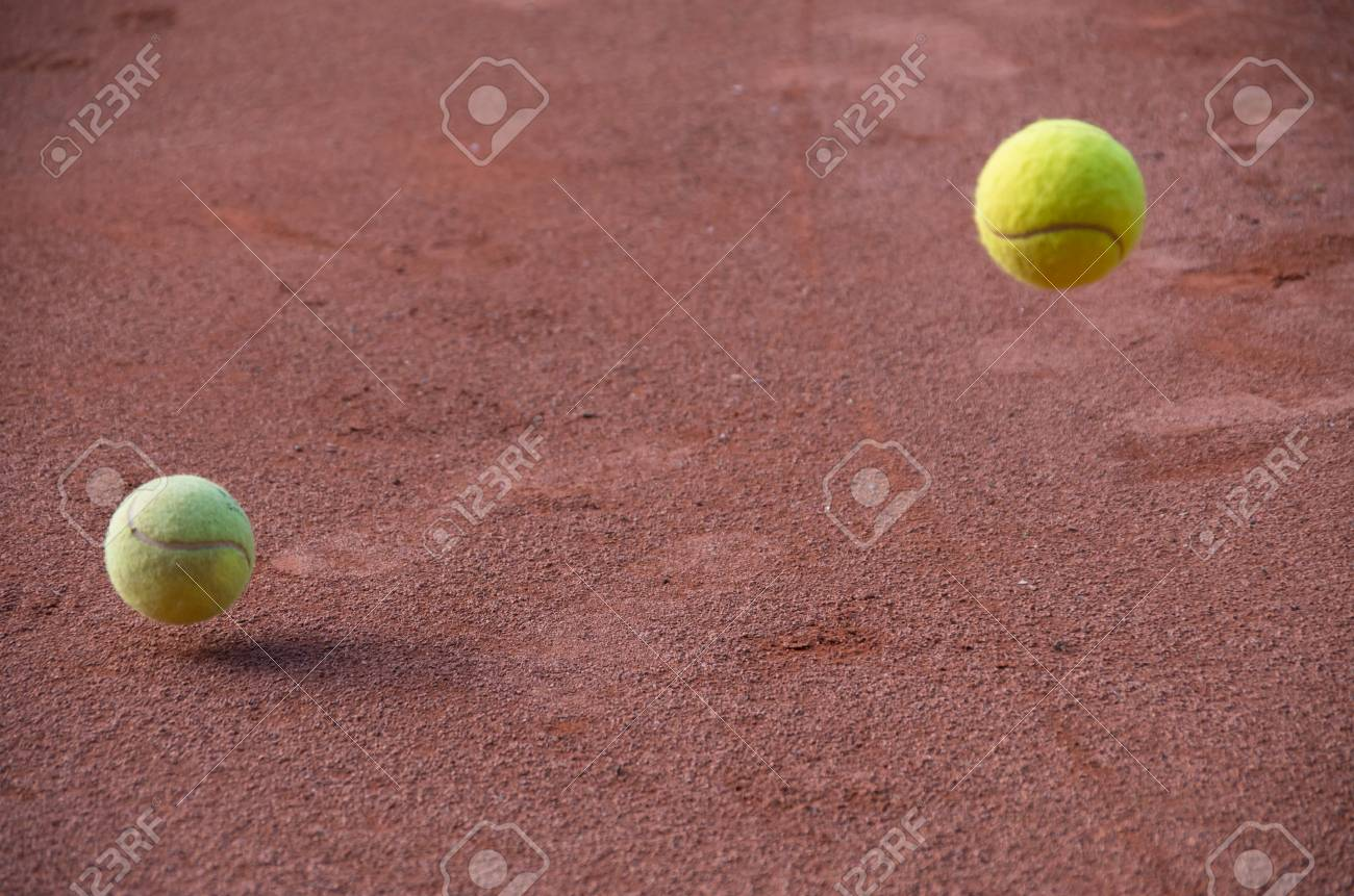 Tennis Ball Bouncing On Court Stock Photo Picture And Royalty Free