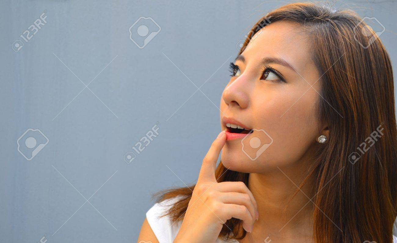 Beautiful young asian woman thinking Stock Photo - 15610961