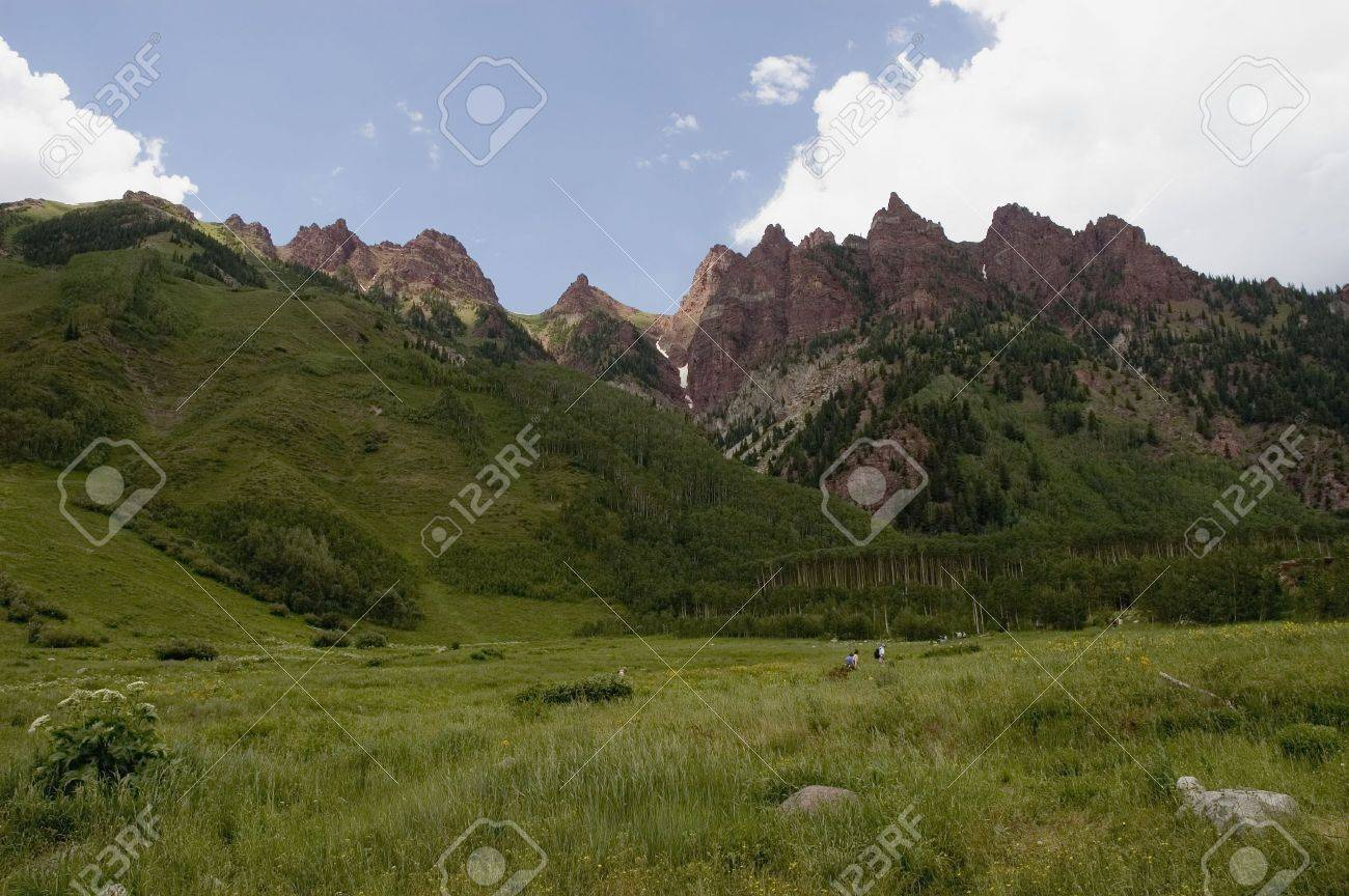 Hikers in a mountain meadow Stock Photo - 326387