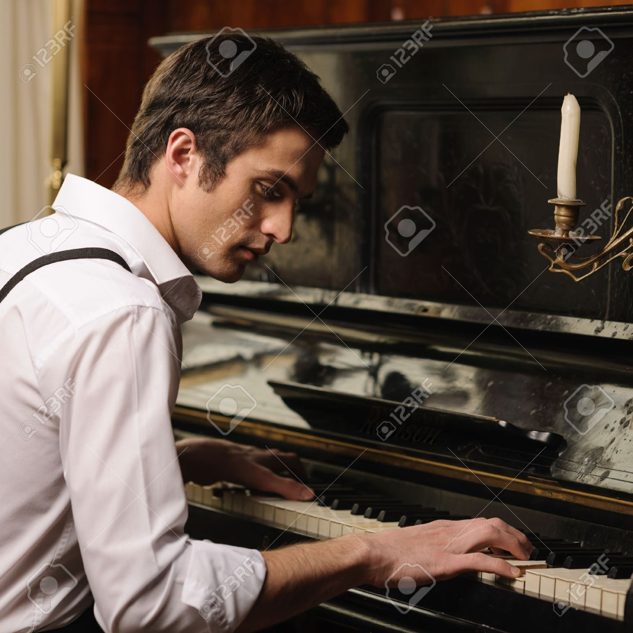 Image result for images of a man playing a piano