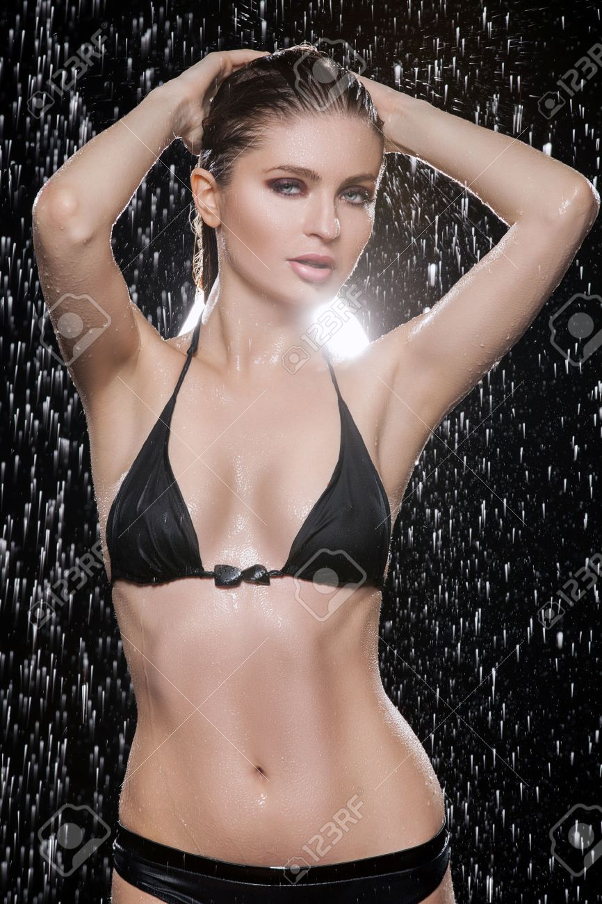 beautiful wet women beautiful wet women in black bikini posing