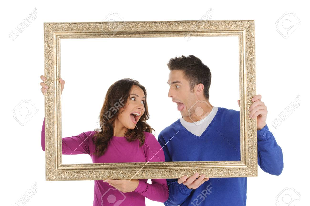 Paar Im Rahmen. Schöne Junge Paar Mit Einem Bilderrahmen Und Verzog ...