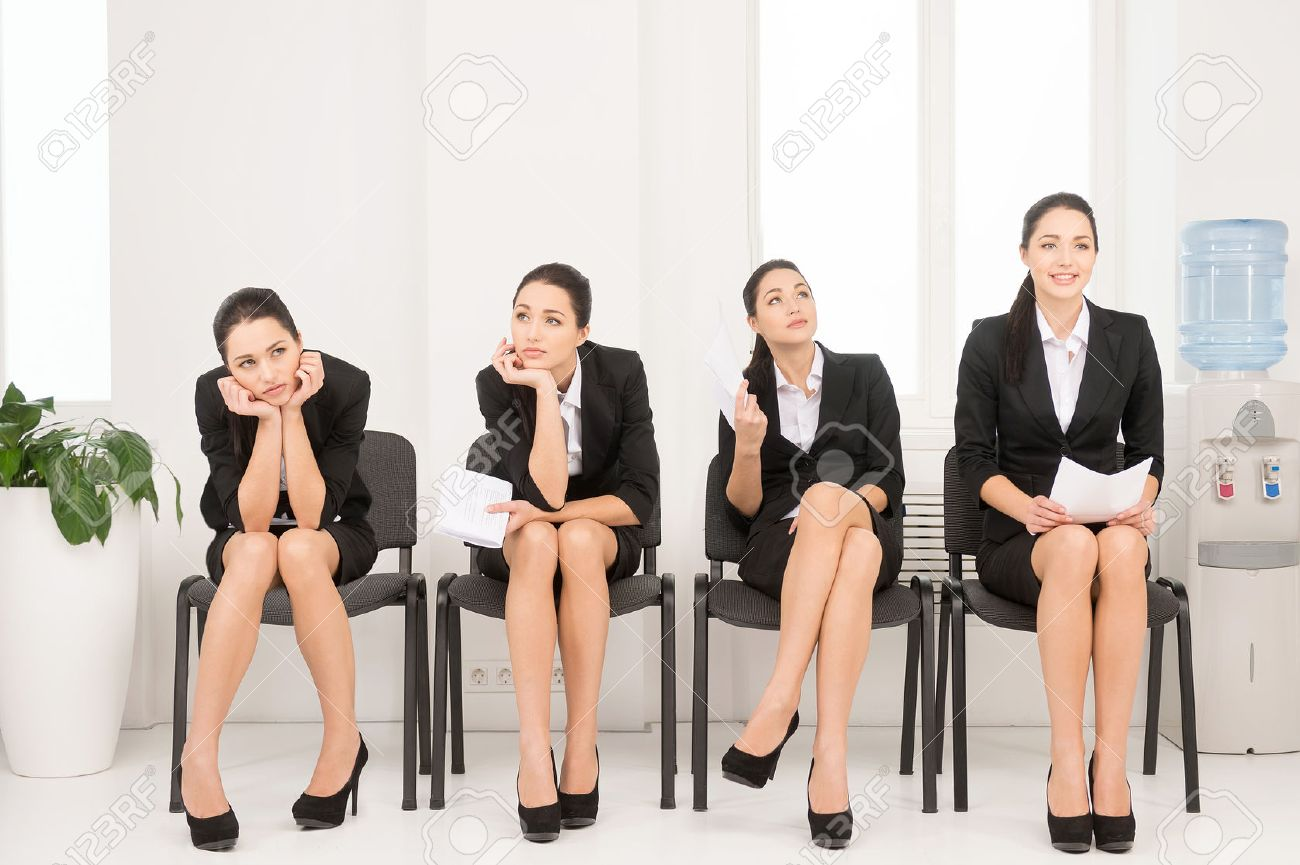 four different poses of one w waiting for interview sitting four different poses of one w waiting for interview sitting in office on chair