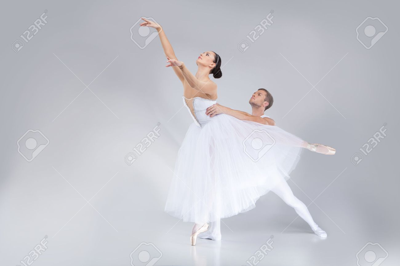 two young ballet dancers practicing. attractive dancing performers acting on stage - 27056355