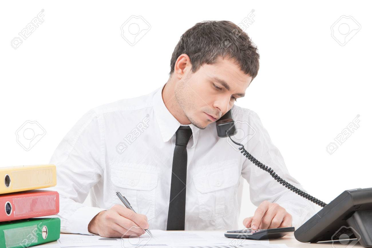 hardworking young man talking on phone young businessman sitting
