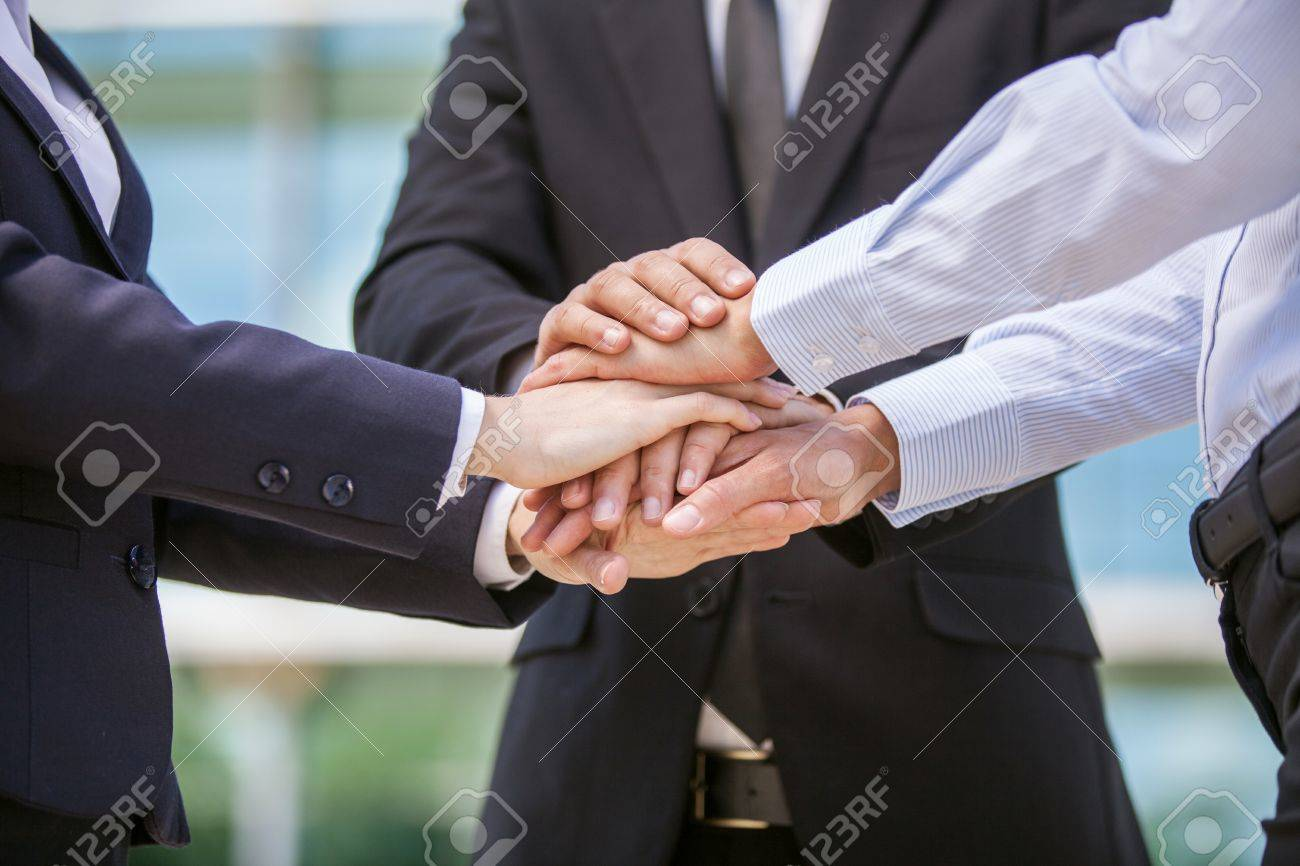 Closeup of business team holding hands together. close-up of three hands on top of each other - 30866412