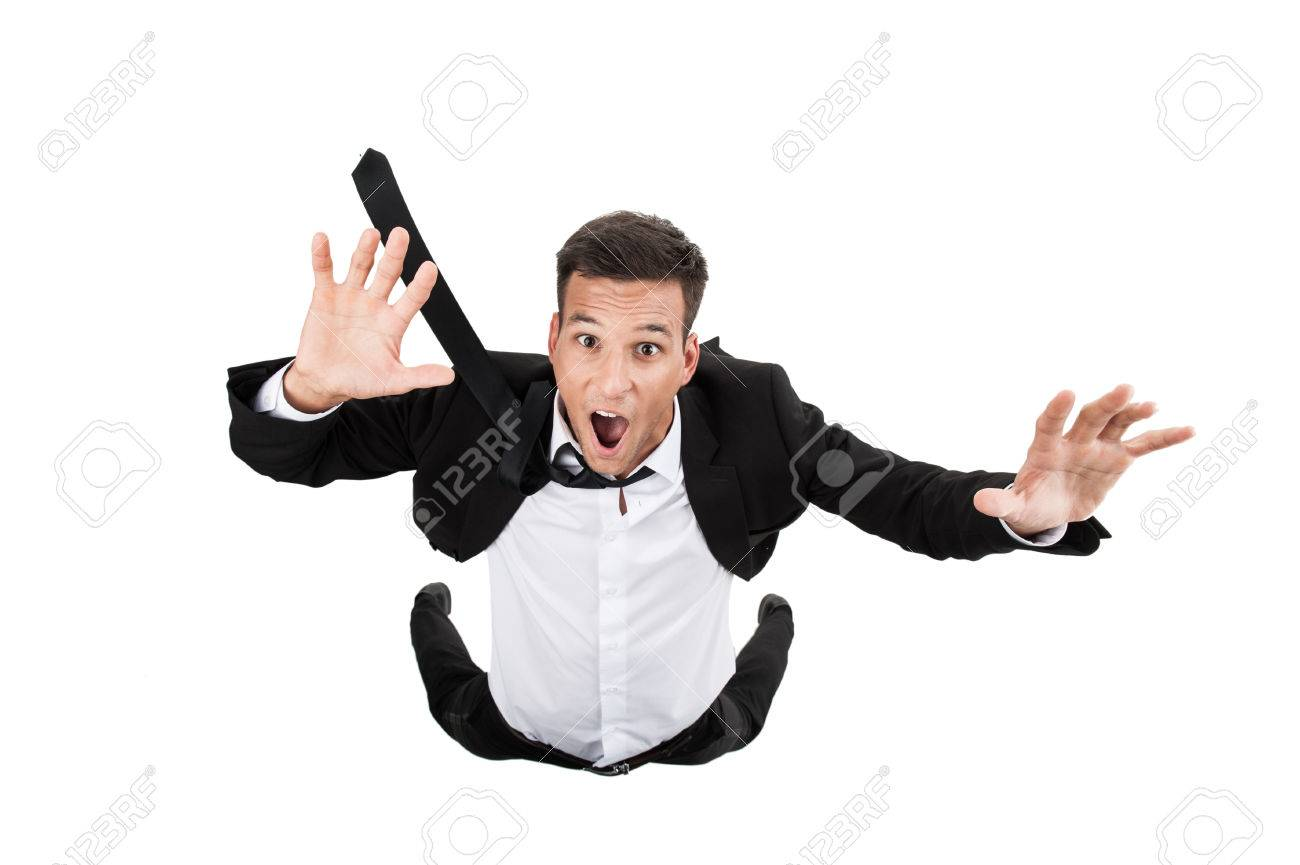 Scared young businessman in falling position. flying businessman on white background and crying - 30902870
