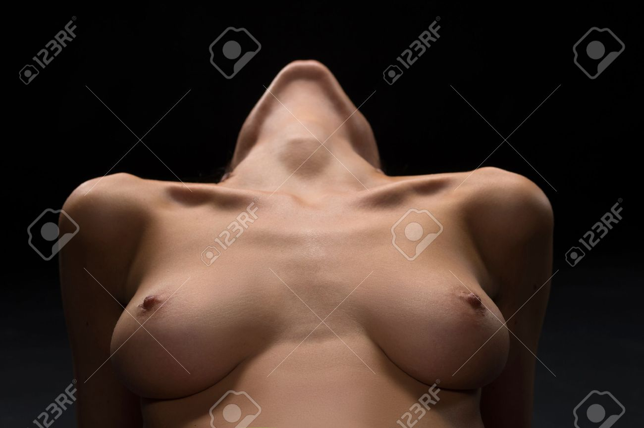 naked breast with nipples of young woman. sexy naked girl closeup view on  black background