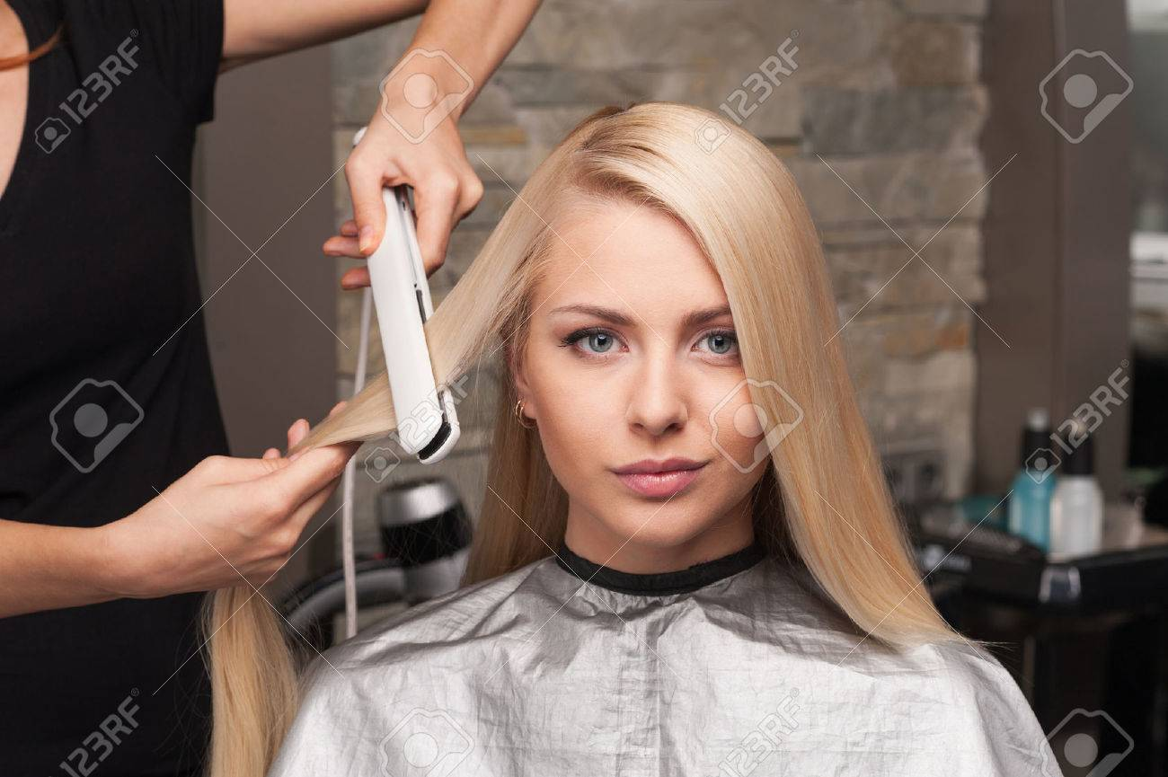 Closeup On Young Woman Getting New Haircut By Hairdresser At Parlor
