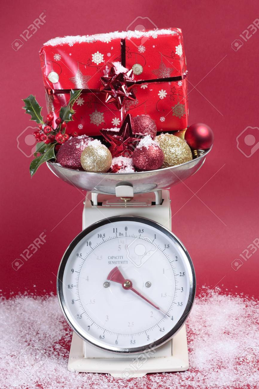Christmas decorations on weighig scales Stock Photo - 8293823