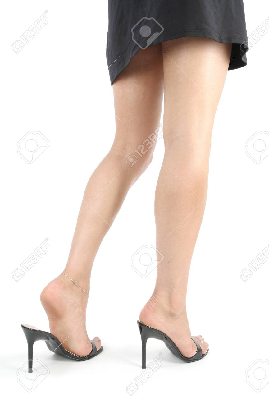 Beautiful woman  legs and feet with black dress over white background Stock Photo - 8371848