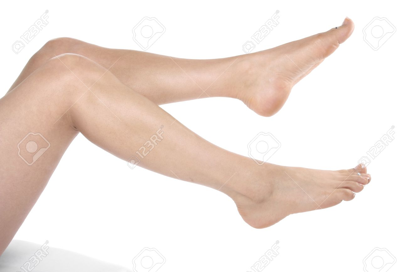 Woman Legs And Feet Isolated Over White Background Stock Photo