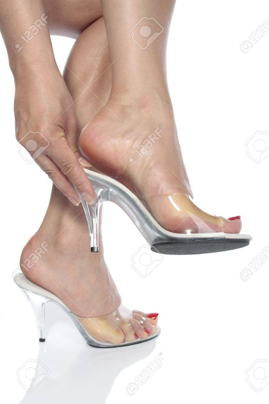 Beautiful Woman Feet And Heel Shoes Over White Stock