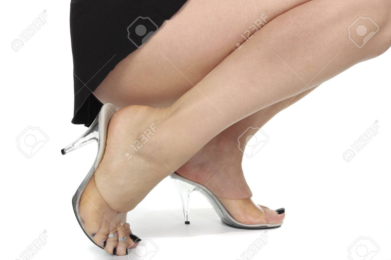 Woman Wearing Clear High Heel Shoes Over White Background Stock ...