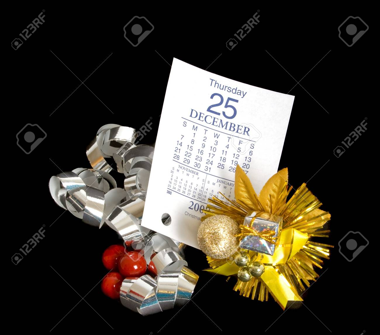 Calendar page showing December 25 2008 with Christmas decorations over black background. Stock Photo - 3217083