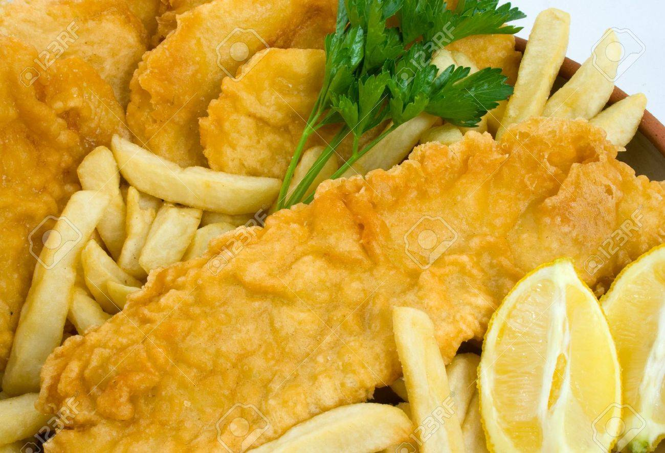 Freshly cooked Fish and Chips with Potato Cakes Stock Photo - 3691280