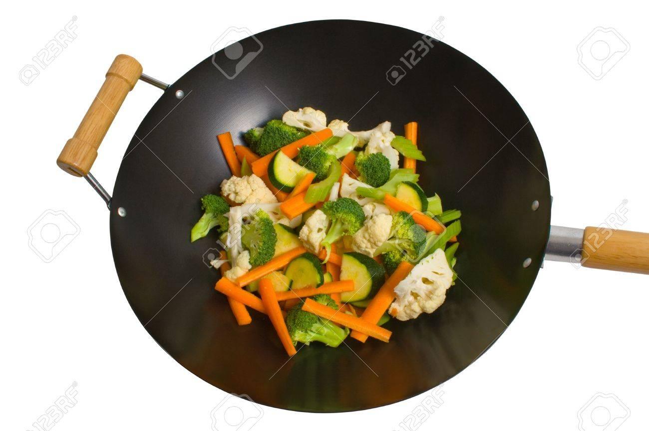 Fresh sliced vegetables in wok over white background. Stock Photo - 3851424