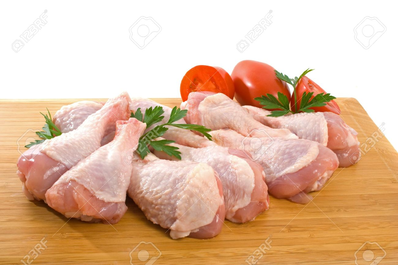 Fresh raw chicken wings on chopping board with roma tomatoes Stock Photo - 3870265