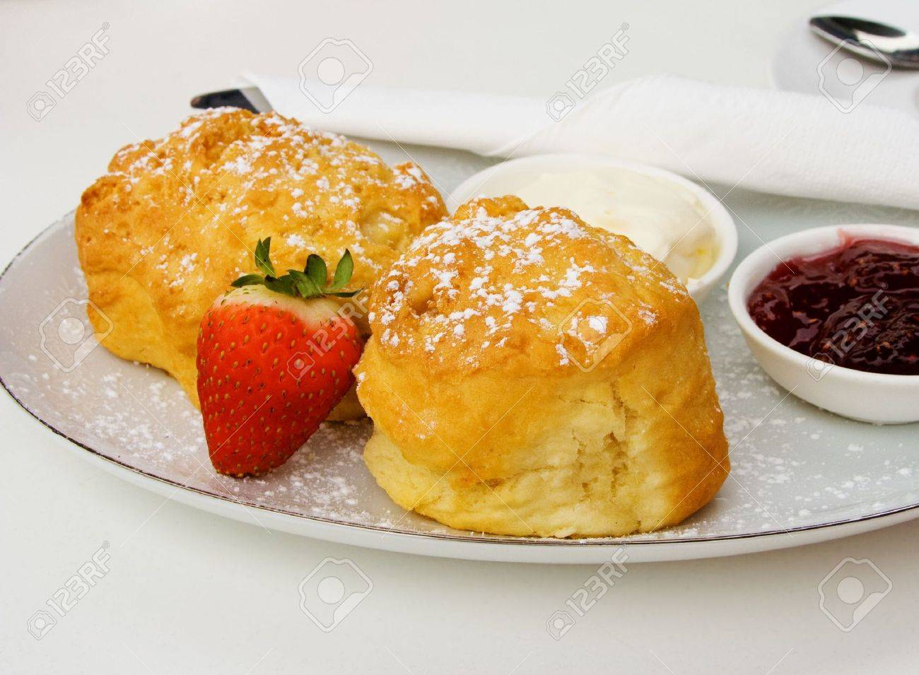 Delicious fresh devonshire scones served with strawberry jam and cream. Stock Photo - 5286976