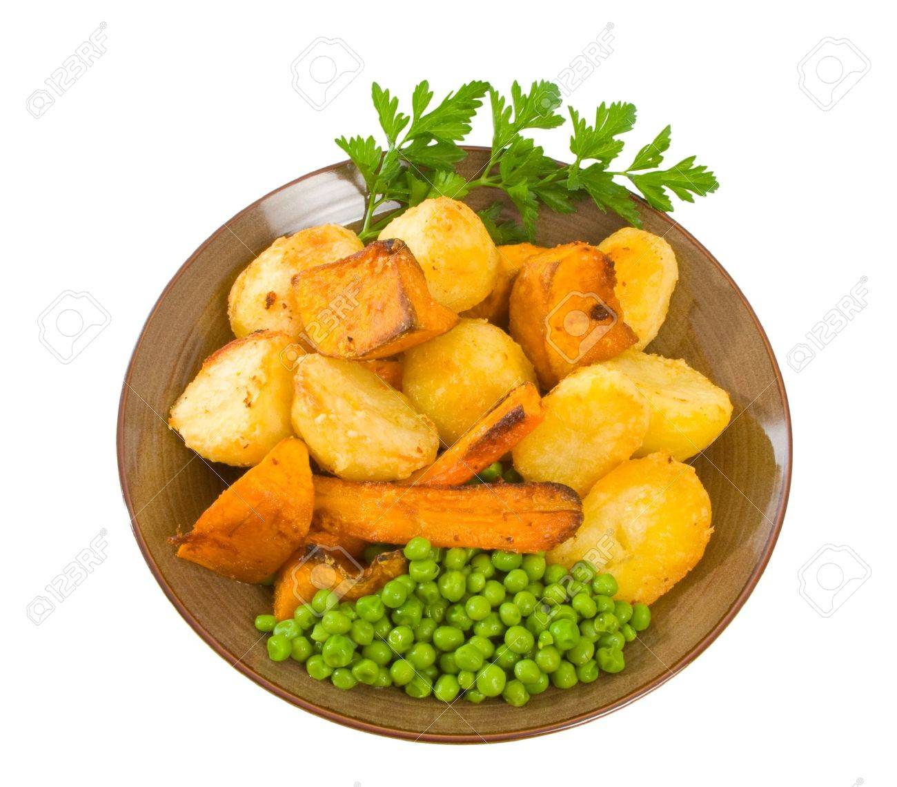 Crisp roast vegetables including potatoes, pumpkin and carrot with peas. Stock Photo - 5286977