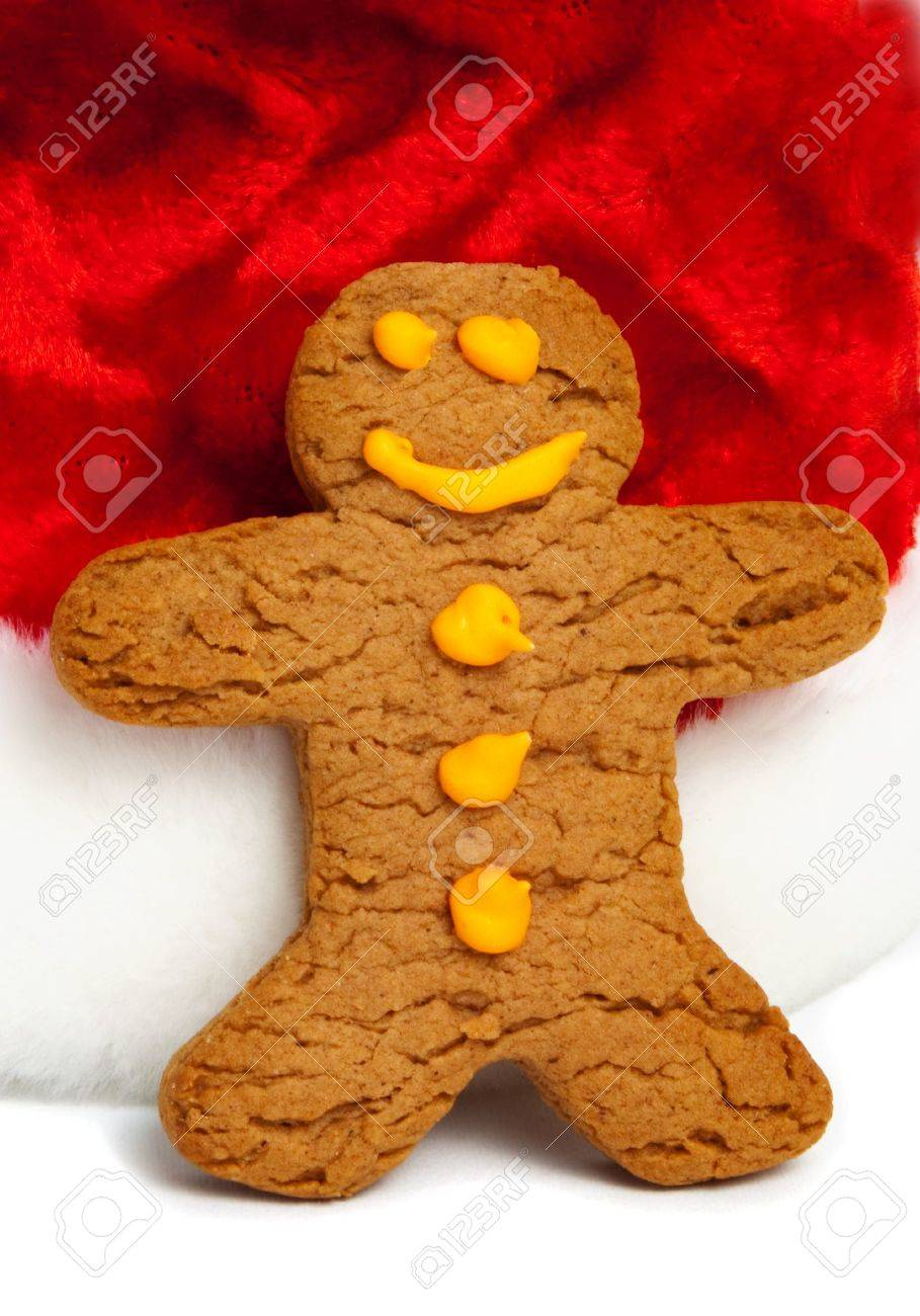 Cute gingerbread man resting against a Santa hat Stock Photo - 6160051