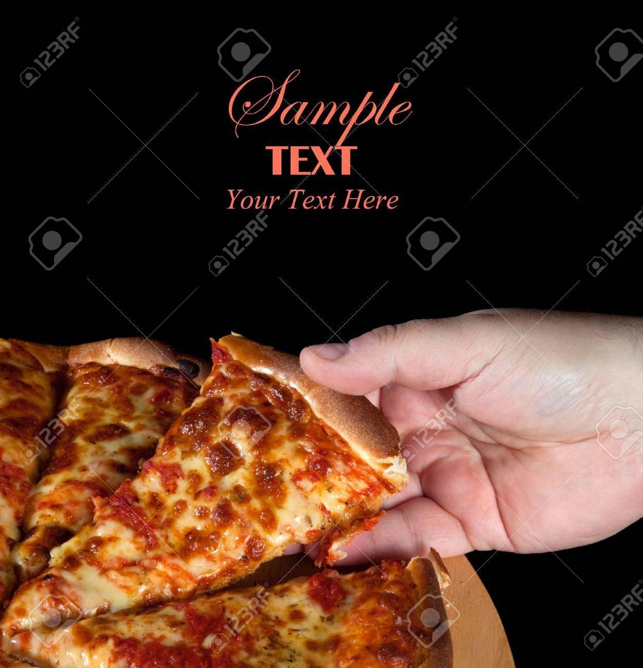 Whole Margharita Pizza over black background Stock Photo - 6200214