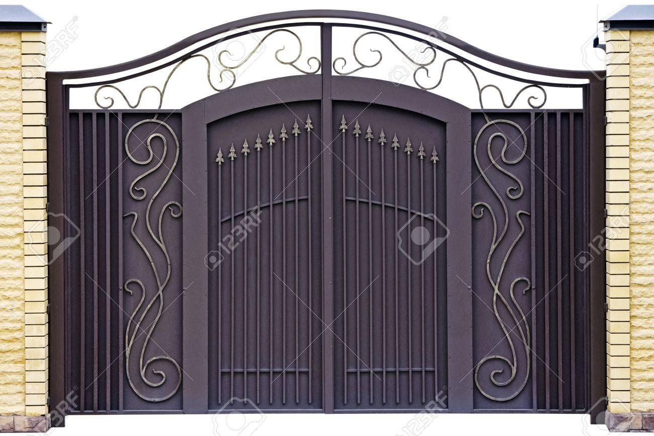 Modern  forged  decorative  gates.  Isolated over white background. Stock Photo - 9260473