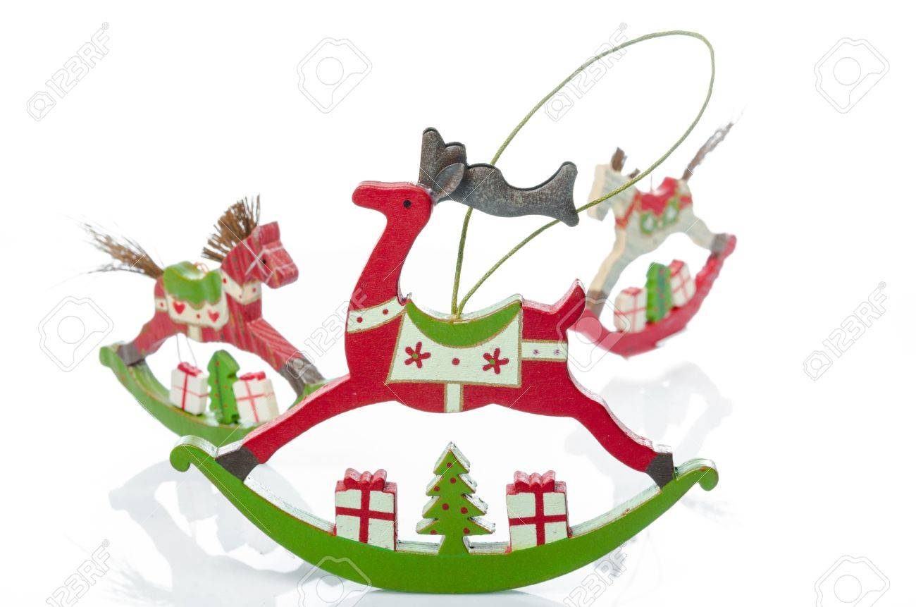 Studio Shot Of Traditional Retro Style Wooden Rocking Horse And Rocking  Reindeer Christmas Decorations, In