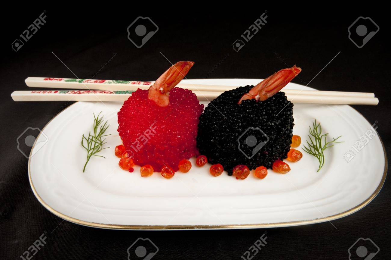 Sushi Covered With Red And Black Fish Eggs Garnished With Dill ...
