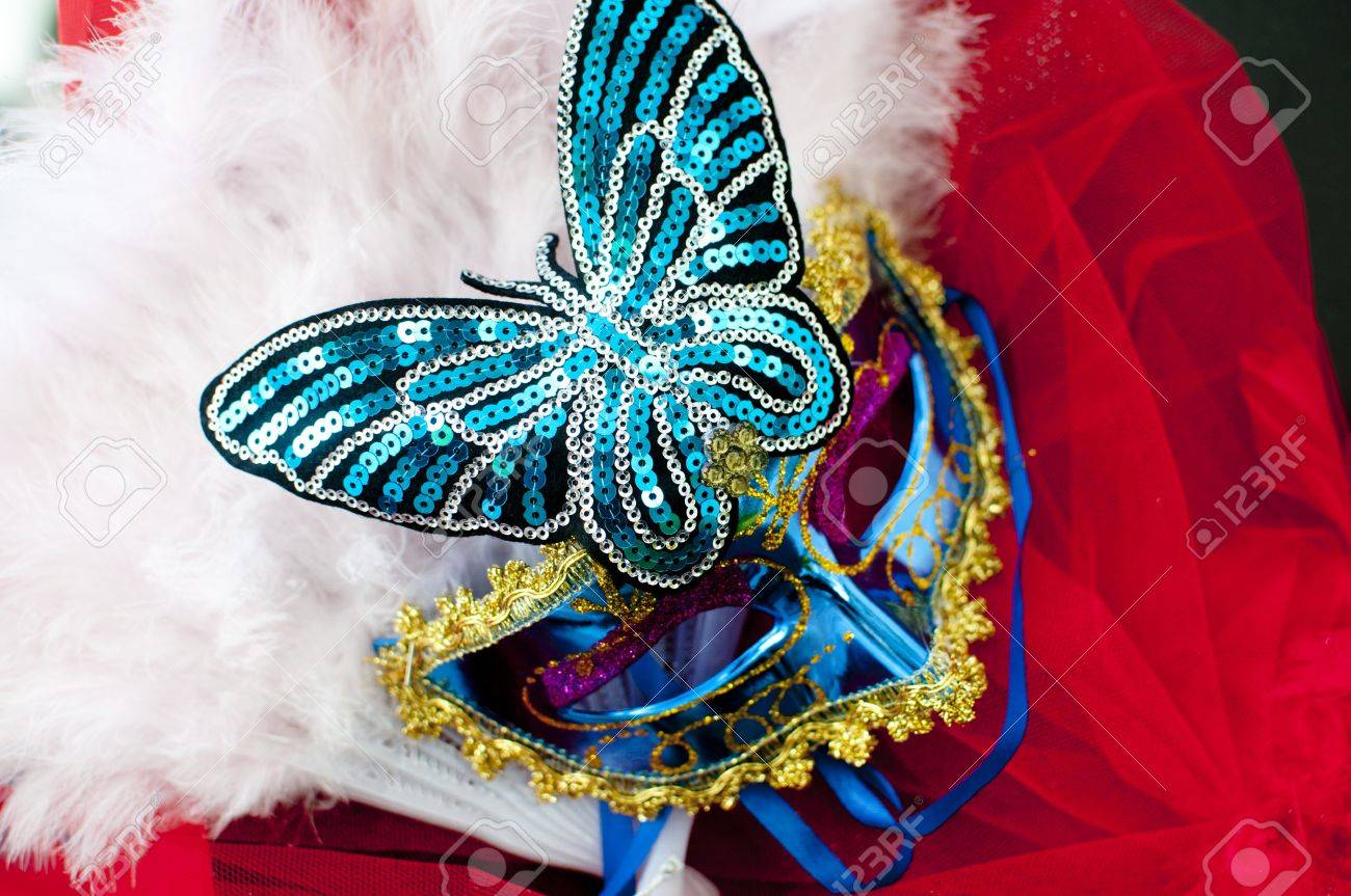 Venetian style sequinned carnival  mask with a butterfly and feathers. Stock Photo - 15417957